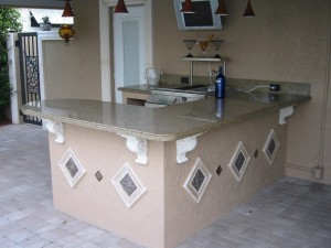 Outdoor kitchen is a bar with no grill but running water, cooler and serving - seating area.