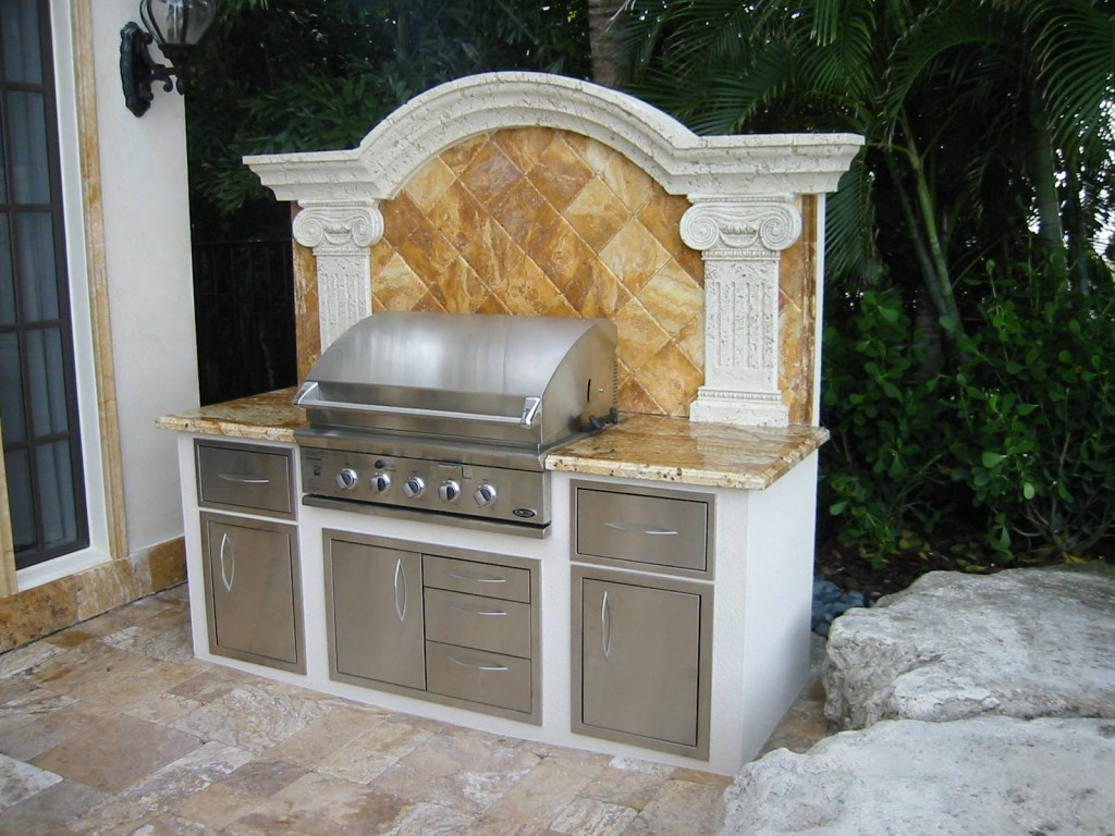 dcs outdoor kitchen with granite counter marble backsplash grill island