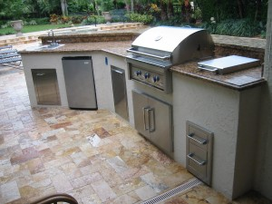 custom outdoor kitchen with infinity gas grill built in with grill accessories