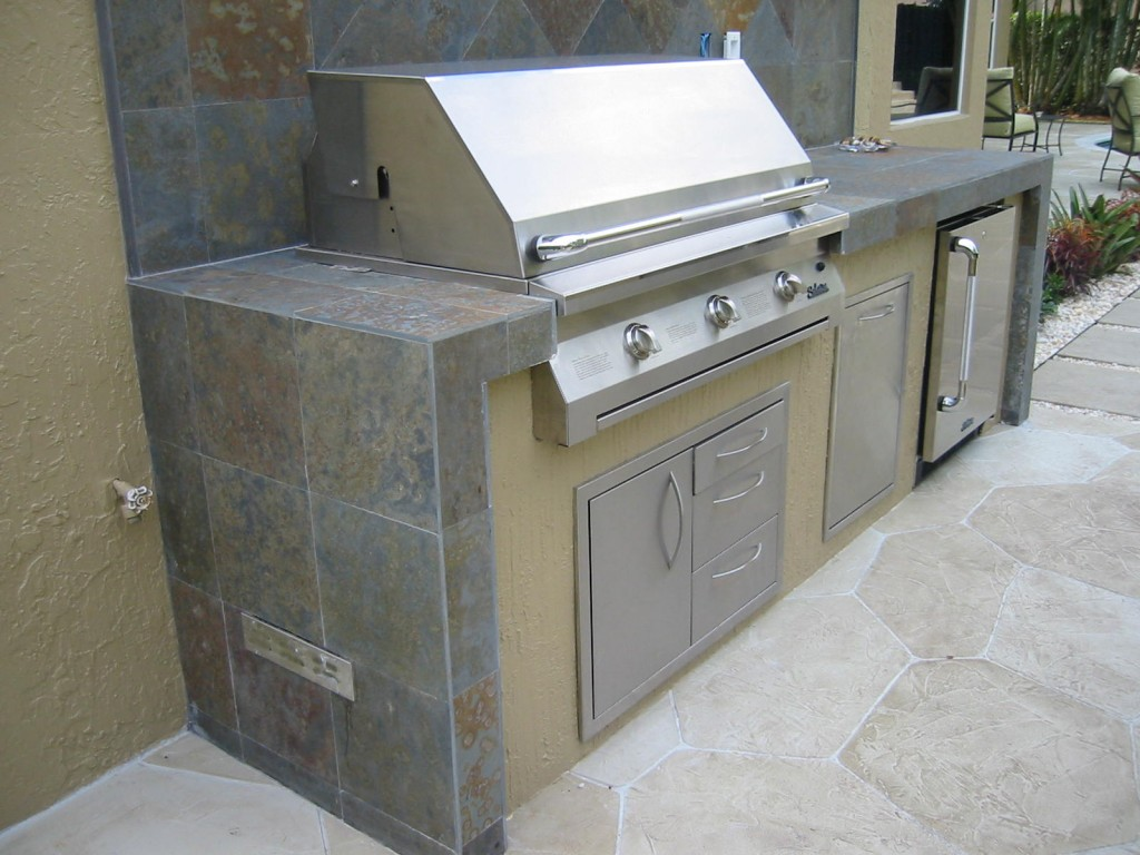 Custom outdoor kitchen grill island with infrared solaire built in gas grill
