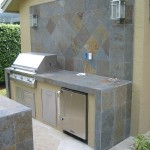 Custom outdoor kitchen with outdoor bar. built in solaire infrared gas grill