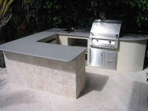 The whole outdoor kitchen with built in alfresco gas grill built in