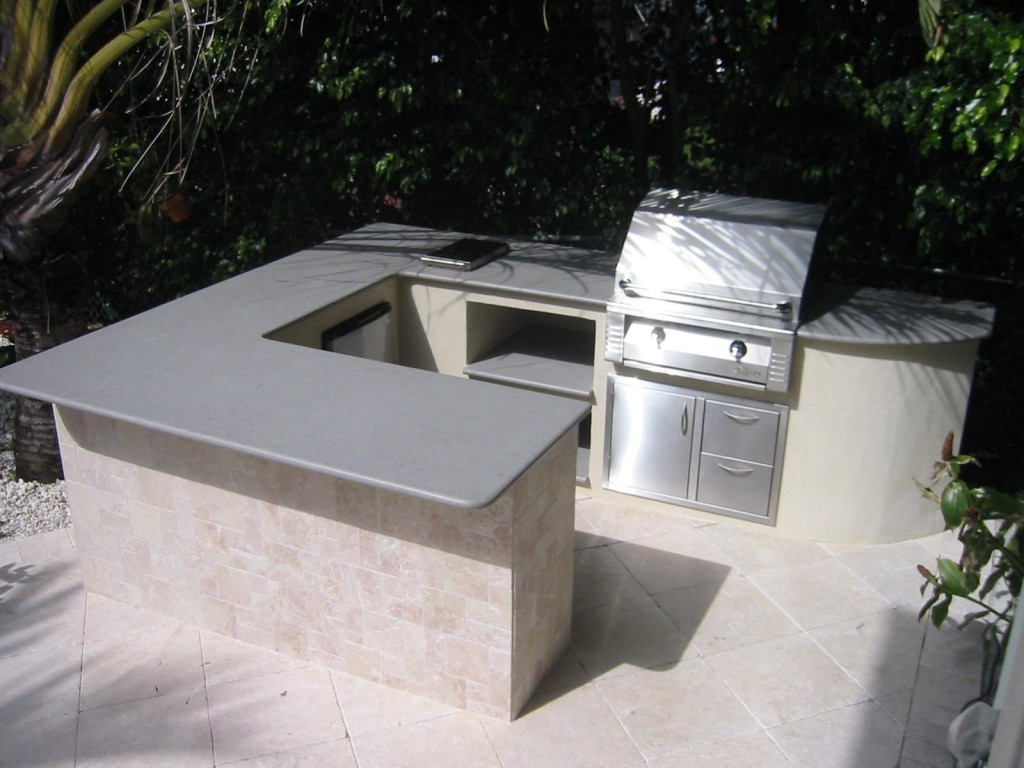 Large outdoor kitchen with alfresco built in gas grill