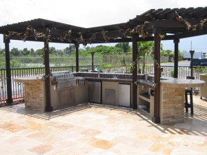 Large outdoor kitchen with custom pergola