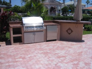 Custom grill island with Alfresco gas grill, built in doors and UL rated refrigerator.