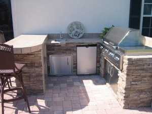 Infrared built in outdoor kitchen with ledgestone and porcelain tile