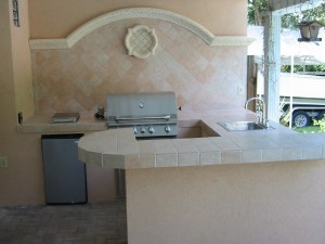 Custom outdoor kitchen with built in Bull outdoor gas grill and custom bar area
