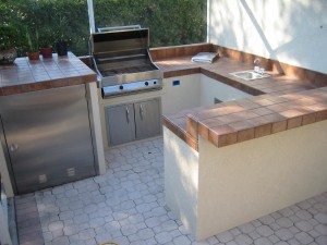 outdoor kitchen and custom bar seating area
