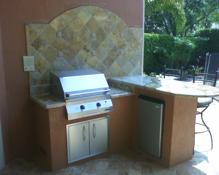 new outdoor kitchen with built in infrared gas grill and custom fabricated granite counter top.