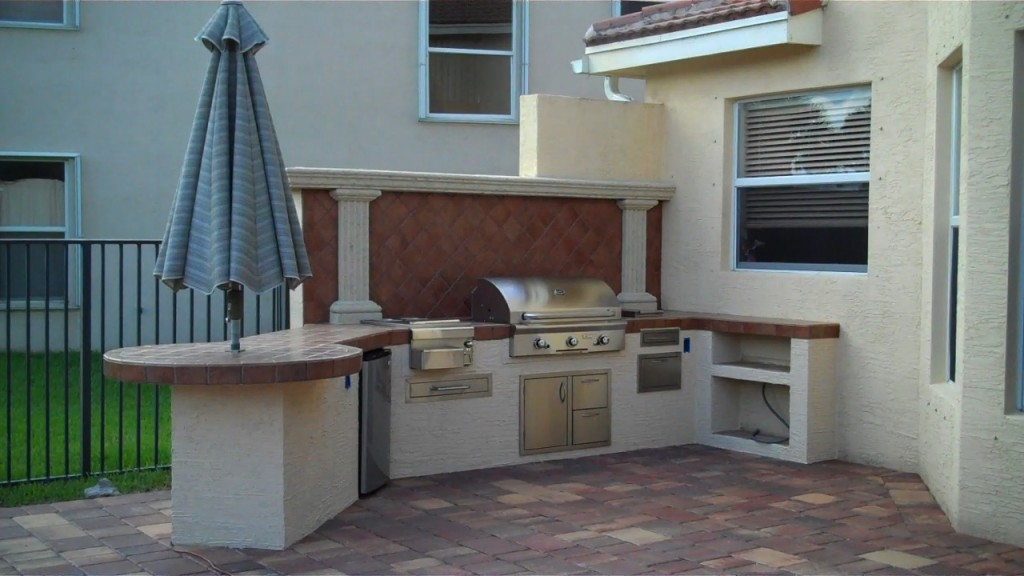 custom outdoor kitchen and bar with a lot of room